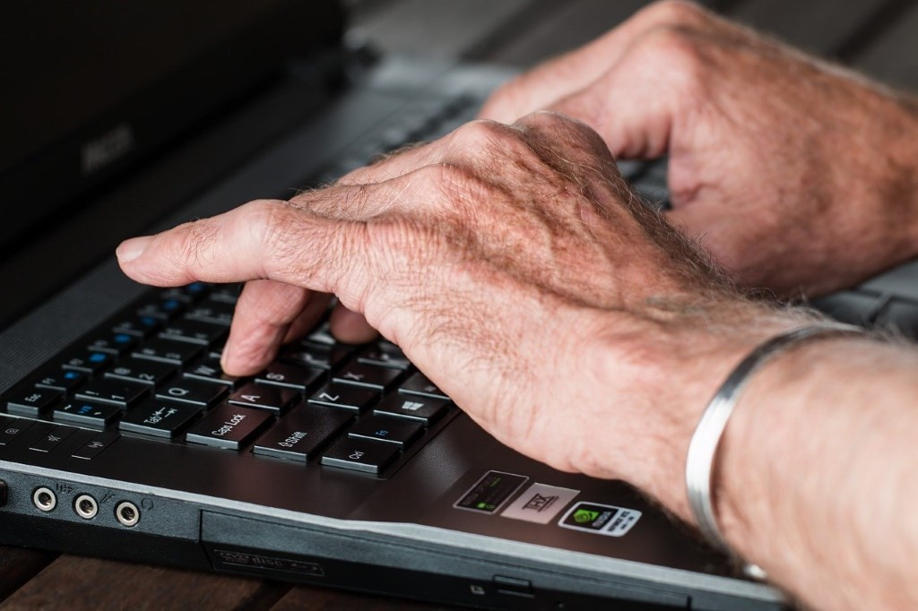 A person's hand on a keyboard  Description automatically generated with low confidence