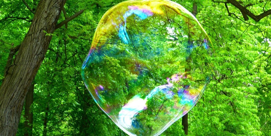 A picture containing tree, bubble, outdoor, colorful  Description automatically generated